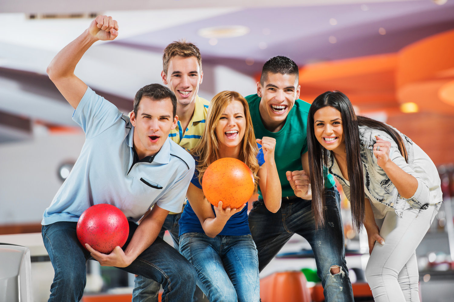 Group of friends bowling together